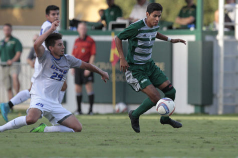 Isaac Flores takes the ball from a UC Santa Barbara player during Sacramento State's men's soccer game on Wedenesday, Oct. 14, 2015. The Hornets upset the Gauchos 5-2.