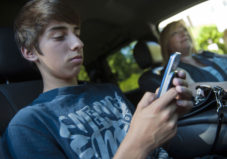 Brandon Gonzales, 12, has been using a cell phone since he was 10. Almost all of his friends have cell phones, too. His mom, Elizabeth Gonzales, likes knowing that he can call home at any time.
