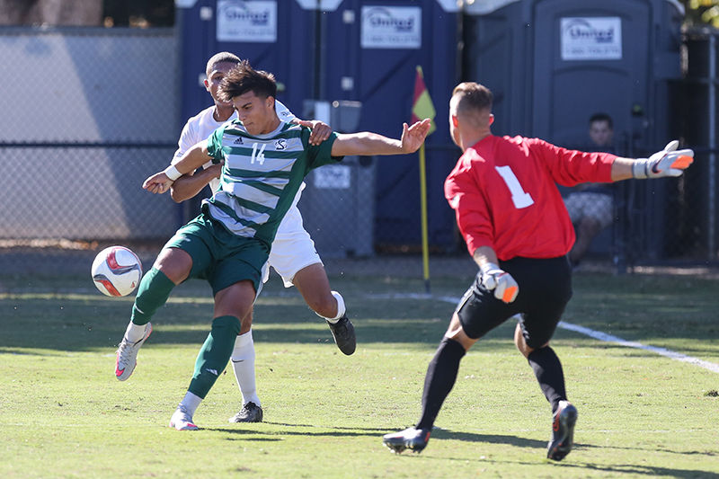 Sac State forward Cylus Sandoval attempts a shot against Cal Poly goalie Wade Hamilton on Saturday, Oct. 31st, 2015 at Hornet Field.