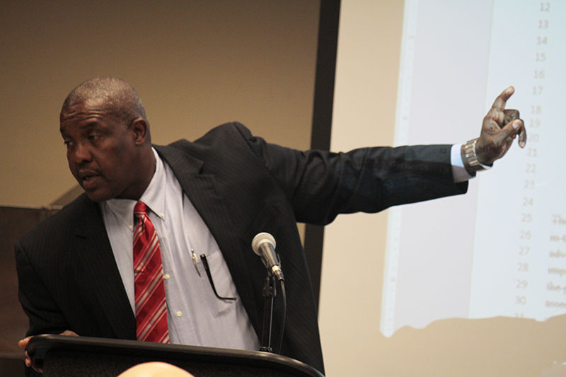 Jim Bowie pointing to measure being addressed at the Faculty Senate meeting Thursday, December 3, 2015 in the University Union.