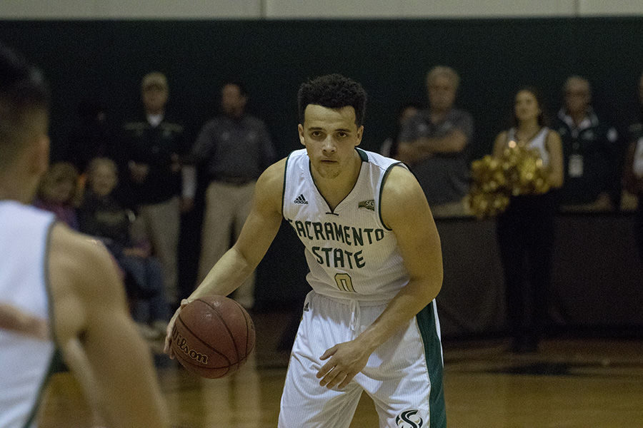 Marcus Graves looks for a pass to Jeff Wu during Sac State's 79-76 loss to Montana State on Saturday, Feb. 6.