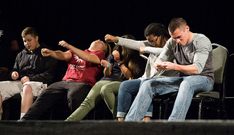 Students get hypnotized at the Tom DeLuca show in the University Union Ballroom, Thursday, Feb. 25.