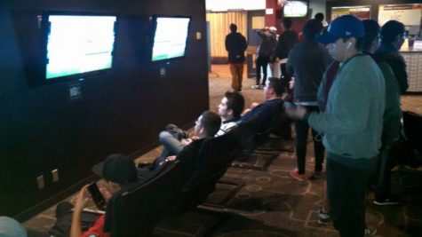 Students gather in the Games Room to join in on the FIFA 16 tournament.