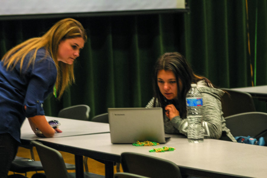 A student receives help on her FASFA on Thursday, Feb. 11, 2016 in the Union Redwood.