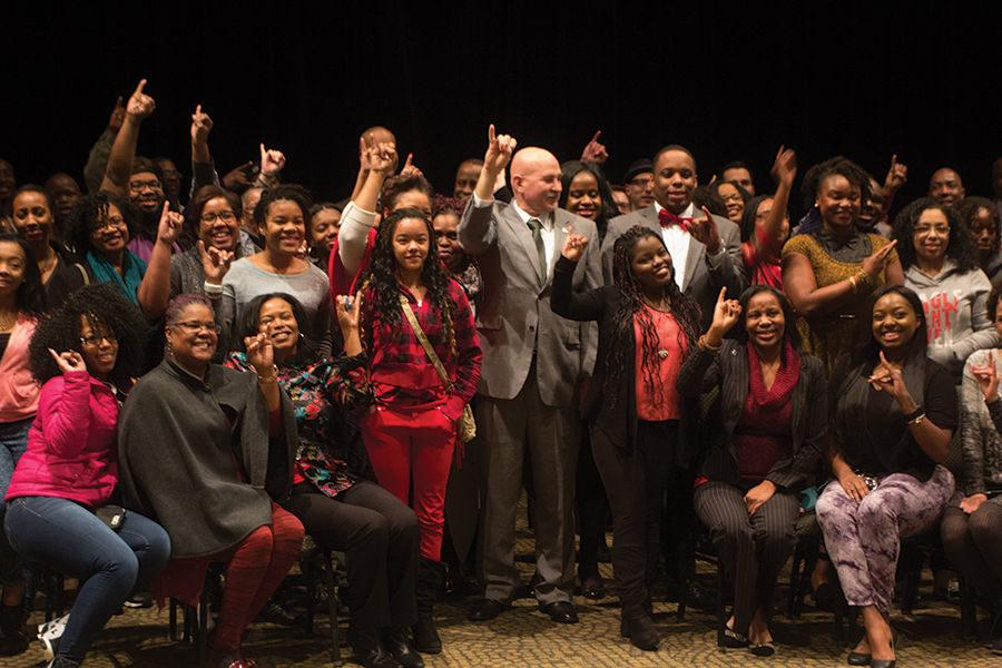 "Everybody posing ""Stingers up!"" at the Black History Month Kick-Off Luncheon,"