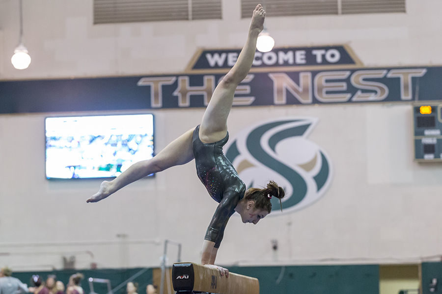 Sacramento State gymnast Cassie Benning performs the beam event at the Nest on Feb. 8, 2016. The gymnastics team will host Flip Fest on Friday. (File Photo - The State Hornet)