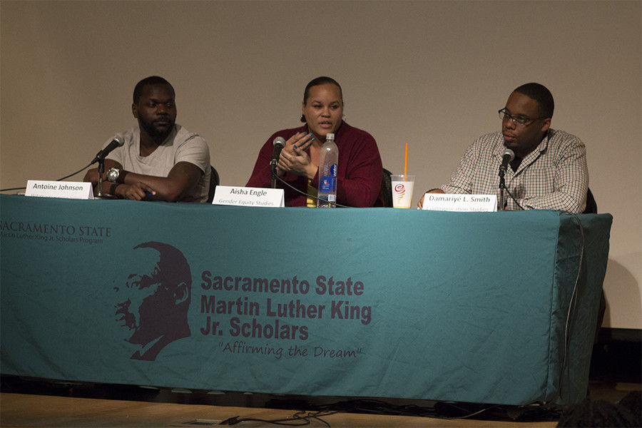 (Left to right) Seniors Antione Johnson, Aisha Engle, Damariy`e L. Smith answer questions on the struggles of a black graduate student in the University Union Hinde Auditorium on Tuesday, Feb. 16. The event is sponsored by the Martin Luther King Jr. Center.