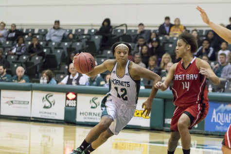 Ashlyn Crenshaw drives the lane against Bianca Littleton of Cal State East Bay on Sunday, Nov. 8, 2015 at the Hornets Nest. Crenshaw led the Hornets offensively with 21 points.