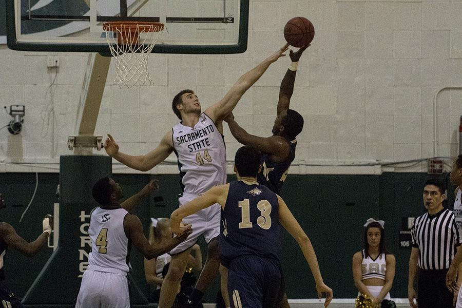 Sacramento State center Eric Stuteville blocks a shot against Montana State on Saturday, Feb. 6, 2016. Stuteville finished the game with 5 points and one block in a 79-76 loss.