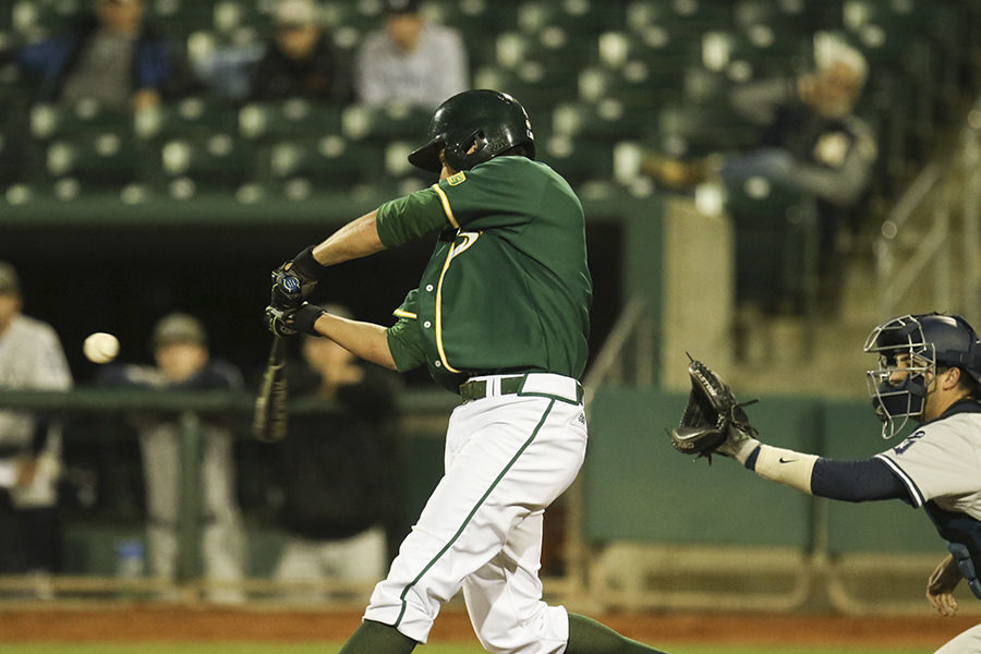 Trent Goodrich swings and makes contact with the ball against Nevada at Raley Field, Wednesday, March 9. The Hornets beat the Wolfpack 5-2.