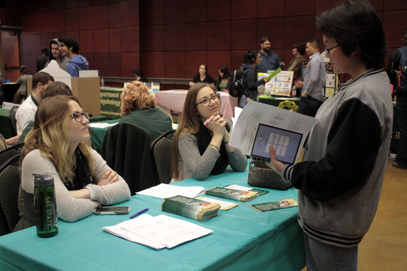 Samantha Lindsay, Clair Just and Tina Payanouvong discuss majors during the ASI Major Fair in the Univesity Union Redroom, Monday, March 8, 2015.
