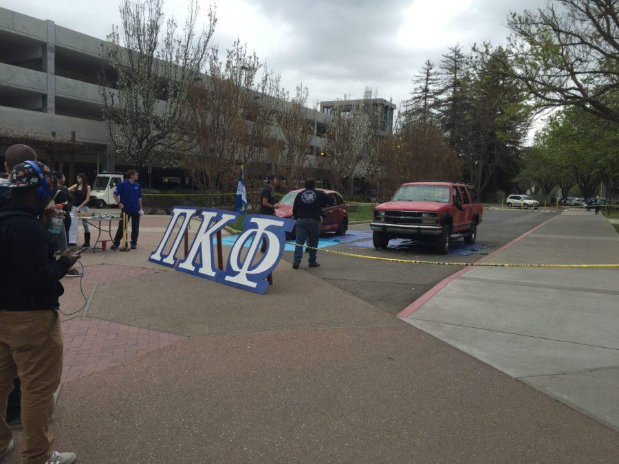 Pi Kappa Phi displays two junk cars outside the Hornet Bookstore on Thursday, March 3. Students could donate $3 to smash these cars with sledgehammers as part of the fraternity's