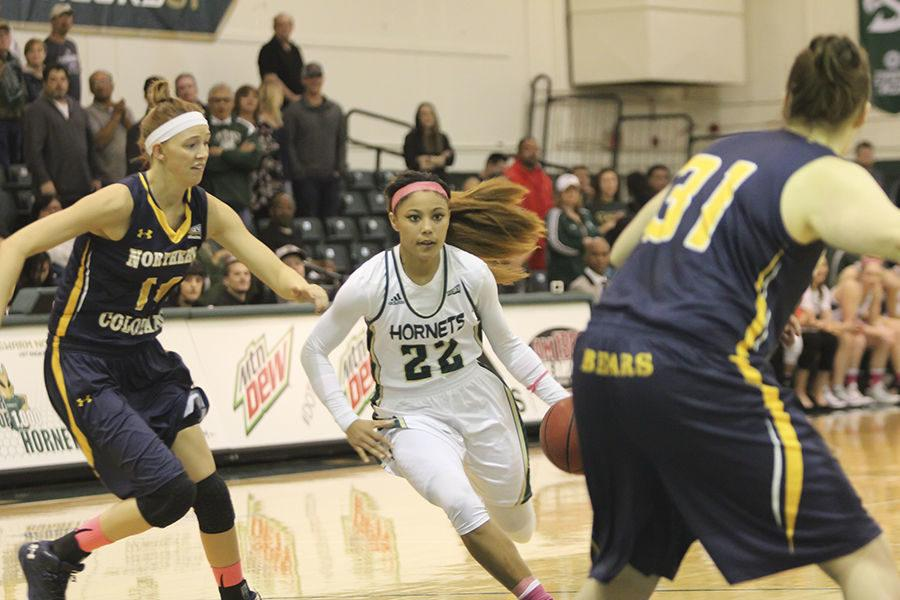 Sophomore Maranne Johnson drives an Northern Colorado defender at the Hornets Nest, Thursday, Feb. 25. Johnson played a big part in a Hornets 83-72 win as she had 20 points, five rebounds, and two steals.