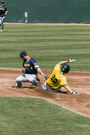 Sophomore Andrew McWilliam steals second base at John Smith Field, April 3. The Hornets defeated the Bears 6-3.