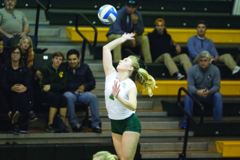 Kennedy Kurtz gets set to serve the ball against Idaho State on Friday, Nov. 6, 2015 at the Hornets Nest.