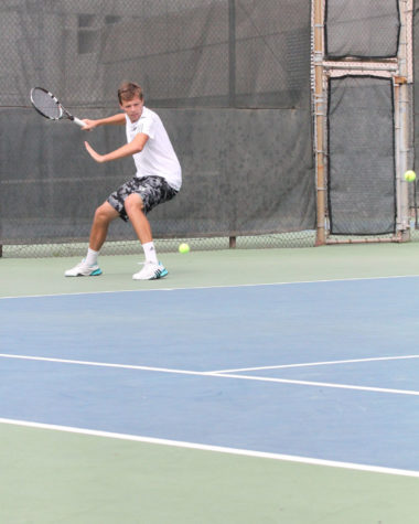 Freshman Mikus Losbergs hits a forehand to a Montana State player. The Hornets won 6-1 on Feb. 27 at the Sacramento State Tennis Courts.