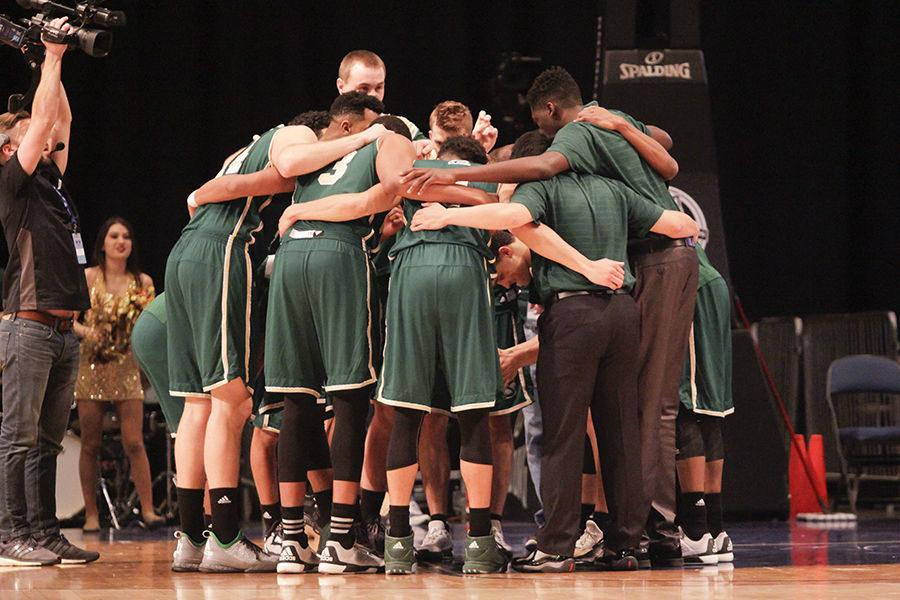 The mens basketball team huddles up before the game against Montana State in the Reno Events Center, Tuesday, Mar. 8.