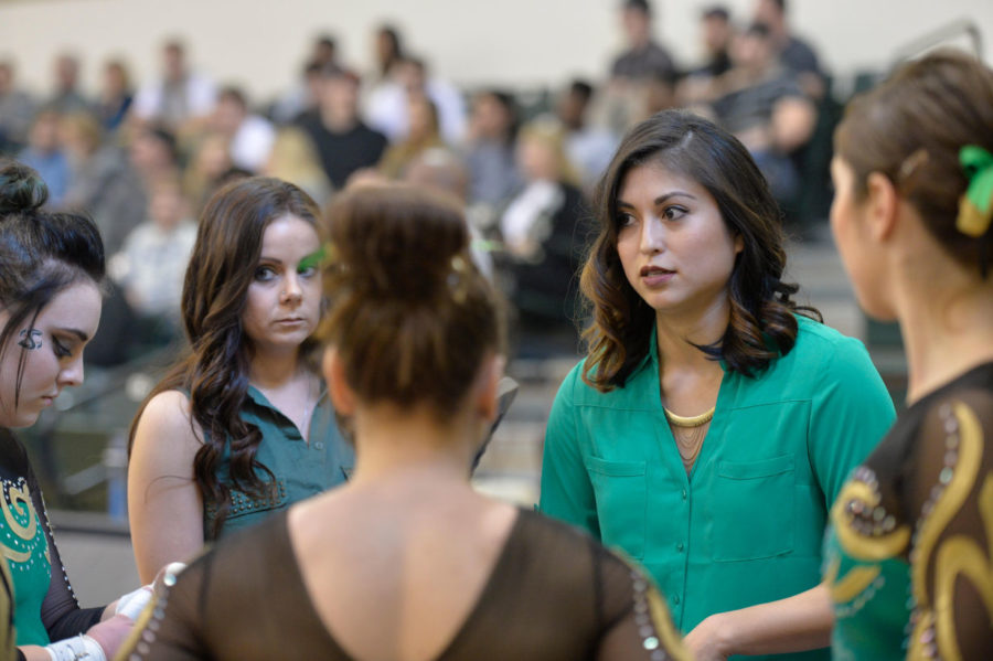 Sac State gymnastics assistant coach Tanya Ho talks to gymnasts before a competition.