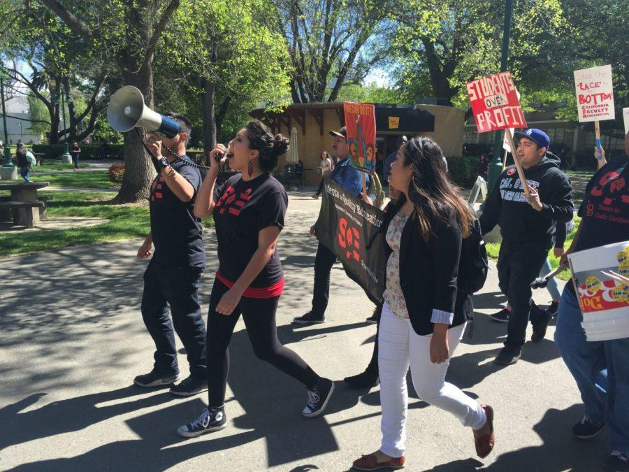 Members of Students for a Quality Education protesting at Sac State with a megaphone after the California Faculty Association's announcement regarding the looming strike and pay dispute with the CSU, Monday, March 28.