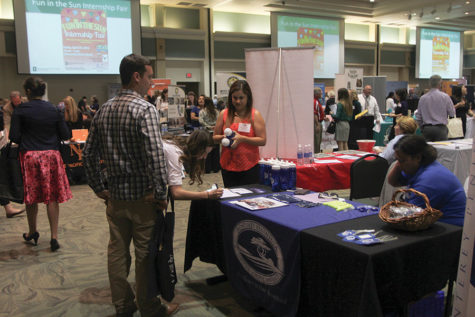 Students and employers converse about possible job opportunities at the Educator Recruitment Expo in the University Union Ballroom on Tuesday, April 19.