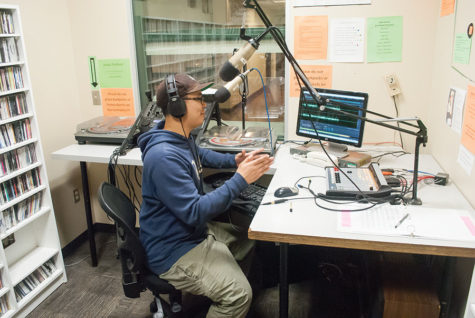 Senior Jerel Labson DJs in the KSSU studio in the University Union, Friday, Apr. 8.