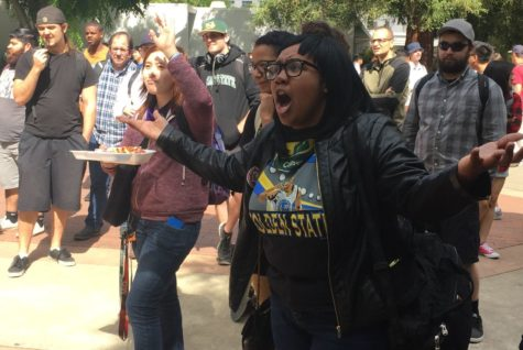 Students at Sacramento State react to a preacher and his interpretation of the Bible on Thursday, April 14. The debate between crowd and preacher lasted for several hours.