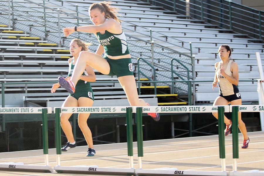 Senior Stephanie Blumm hurdles against UC Davis in the Causeway Classic Dual Meet at Hornet Stadium, Friday, April 29.