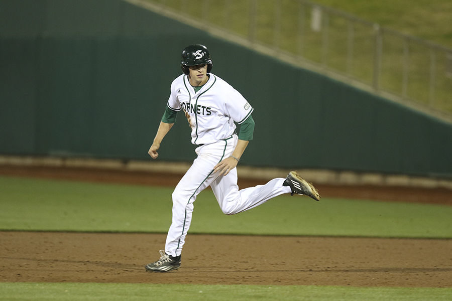 PJ Floyd runs to second base after a past ball against Fresno State at Raley Field, Wednesday, April 27. The Hornets beat the Bulldogs 5-4 in extra innings.