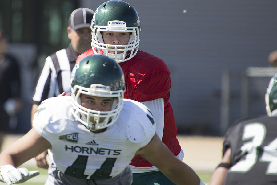 Running back Ernie Timoteo defends Quarterback Nate Ketteringham at Hornet Stadium, Saturday, April 16.