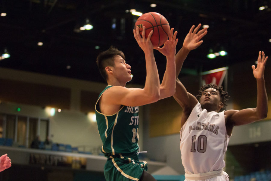 Freshman Jeff Wu takes a shot in the paint against Montana in the Reno Events Center Thursday, March 10. Wu had 11 points, two rebounds and one steal in a Hornets 70-53 loss.