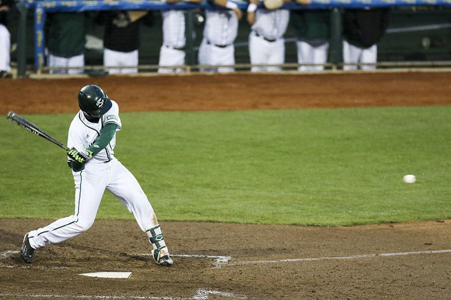 Chris Lewis swings at the ball against Fresno State at Raley Field, Wednesday, April 27. Lewis went two for six at the plate and scored two runs.