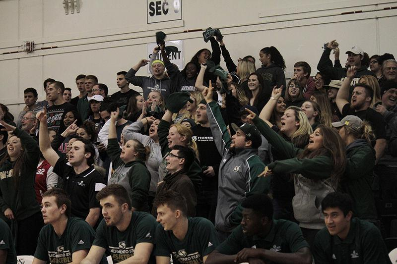 The Green Army cheering and showing school spirit during Sacramento State's men's basketball game against UC Davis on Tuesday, Nov. 24, 2015 in the Hornets Nest