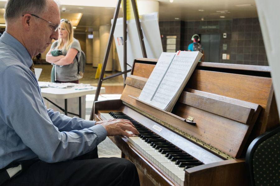 Kirtland Stout plays the piano to raise money for March of Dimes in the University Union Lobby, Wednesday, April 20.