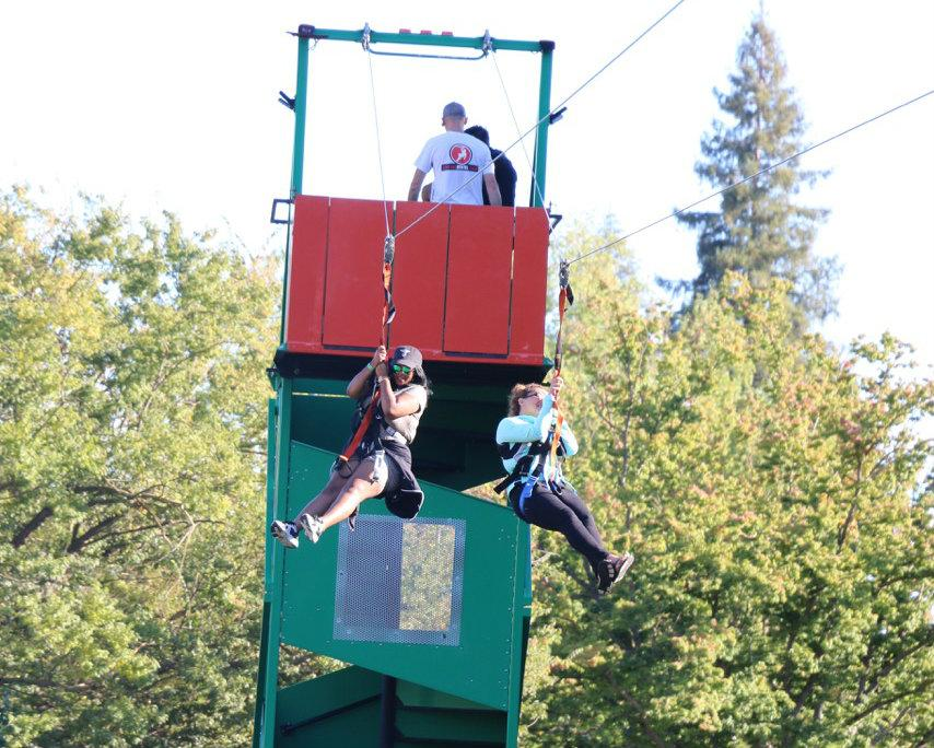 Two students zip line through the Residence Hall squad at the ASI Block Party, Sept. 17, 2015.