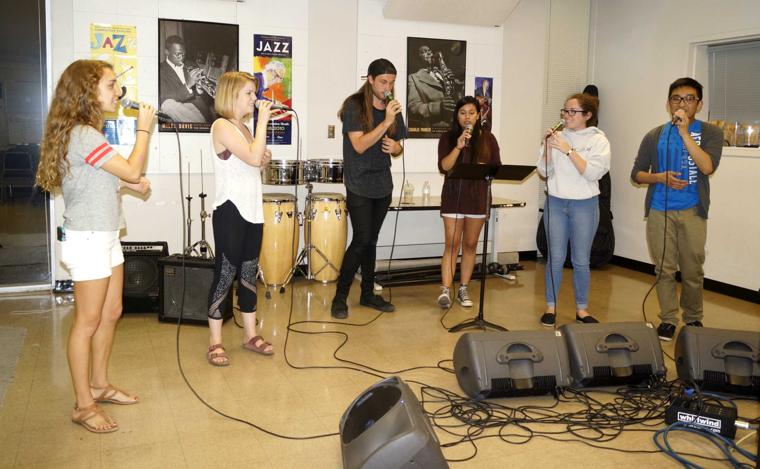 Members of jazz vocal group C-Sus Voices rehearse together to prepare for their performance at the Monterey Jazz Festival on Sunday, Sept. 18. (Photo by Marivel Guzman)