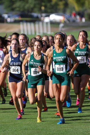 Sacramento State senior cross country runners Amanda Garcia and Chloe Berlioux take off from the starting line at the Aggie Open in Davis, California on Sept. 4, 2015. (Photo by Francisco Medina)