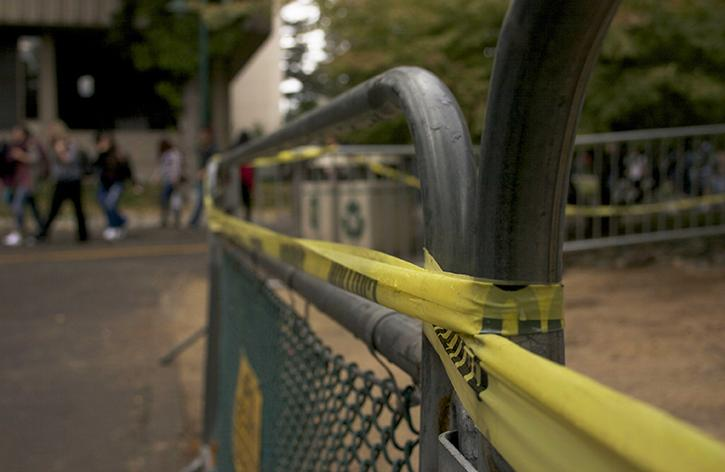 A metal fence cordons off an area south of Santa Clara Hall that initially contained asphalt contaminated with dangerous amounts of lead. The asphalt was removed Saturday and the barrier is expected to come down this week, according to Daryn Ockey, the director of facility operations for Sacramento State. (Photo by John Ferrannini)