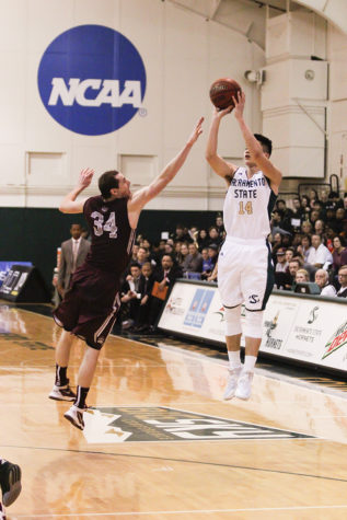 Guard Jeff Wu shoots a three pointer over a Montana State defender, Thursday, Feb. 4, 2015 at the Hornets Nest. (Photo by Matthew Dyer)