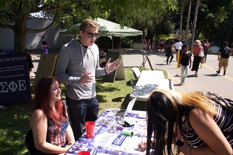 Former Sacramento State College Republicans chairman Ryan Brown, center, speaks with freshman Jazmine Teodechi on Wednesday, September 7, 2016 as she signs up to receive emails from the club as College Republicans executive director Angela Wold laughs at a joke. Brown is the Republican candidate for California State Assembly District 7, challenging incumbent Democrat Kevin McCarty. (Photo John Ferrannini)