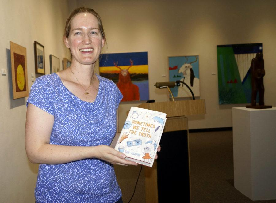Sacramento State's medieval literature professor Kim Zarins's holds a copy of her new novel, Sometimes We Tell the Truth, Thursday, Sept. 8 at the Library Gallery. [Photo by Marivel Guzman]