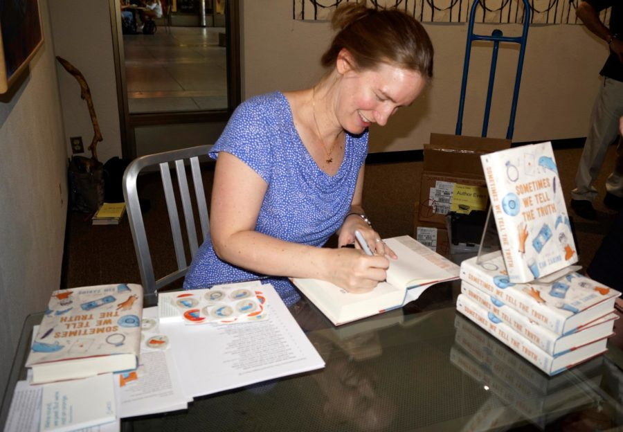 Sacramento State's medieval literature professor Kim Zarins's signs copies of her new novel, Sometimes We Tell the Truth, Thursday, Sept. 8 at the Library Gallery. [Photo Marivel Guzman]