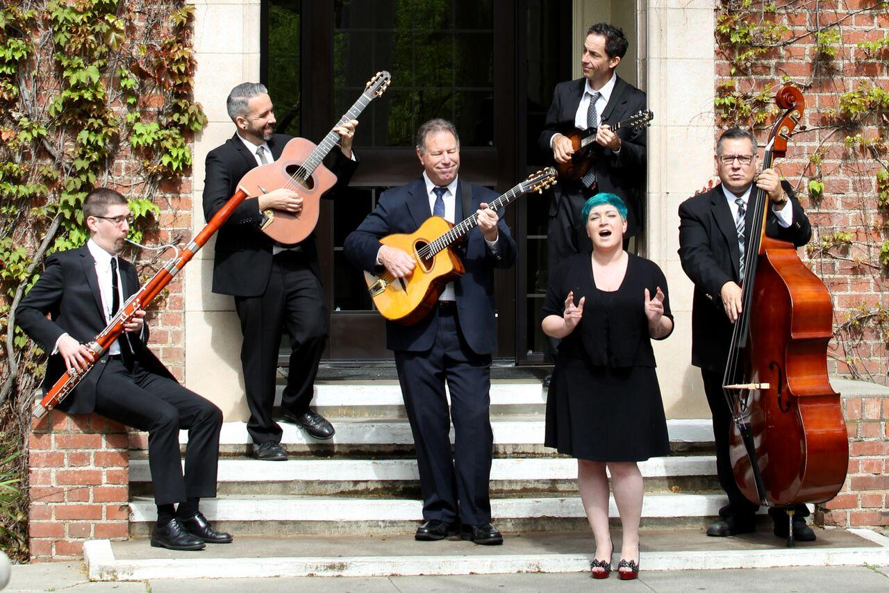 David Wells, Billy Gay, Eric Johnson, Francesca Bavaro, Gary Williams and John Ady of Hot Club Faux Gitane will perform at the Capistrano Concert Hall Sept. 30. (Courtesy of Hot Club Faux Gitane)
