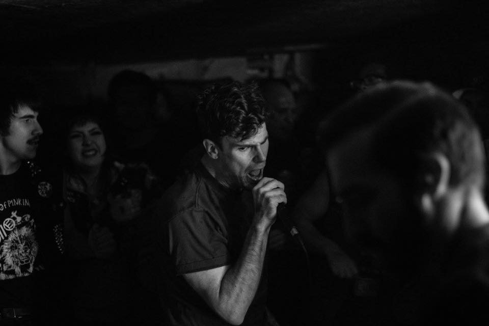 Senior English major Ian Kappos is the lead vocalist of Sacramento-based hardcore punk band Cross Class, whose other members include bassist Ian Boalt, guitarist Mitch Seaman and drummer Craig Hancock. (Courtesy of Bryan Bickel)