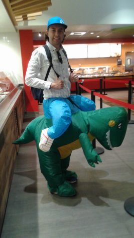 Alex Venturini as a guy riding a dinosaur