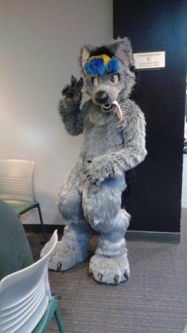 """Randy Wong as a wolf that he named """"Cobalt."""""""