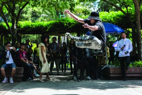 John Cao, senior communication studies major, break dances during the Asian Pacific Islander Fest Day on Wednesday, April 27 in the Library Quad.