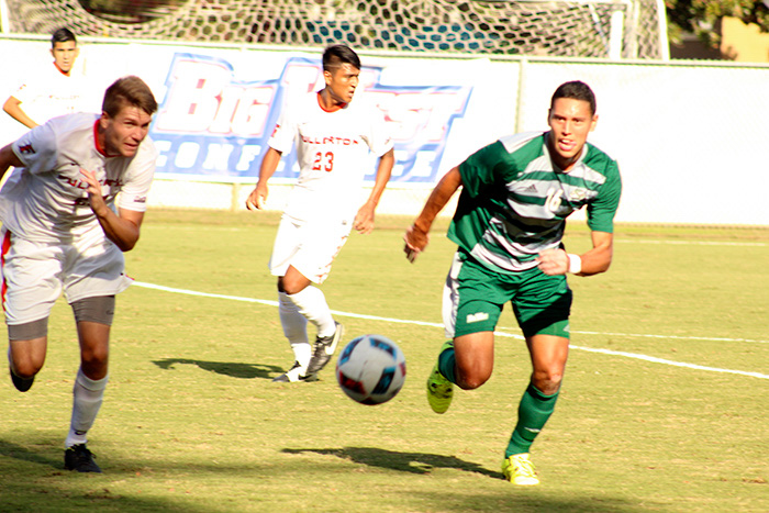 Sacramento State defender John Quintanilla chases after the ball against Cal State Fullerton. Sac State won 1-0 at Hornet Field on Oct. 6, 2016. (Photo by Joseph Daniels)