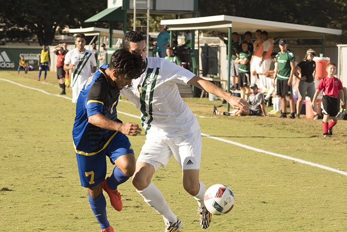 Sacramento State midfielder Christian Webb attempts to get passed UC Riverside midfielder Emilio Huerta at Hornet Field on Oct 8. (Photo by Joseph Daniels)