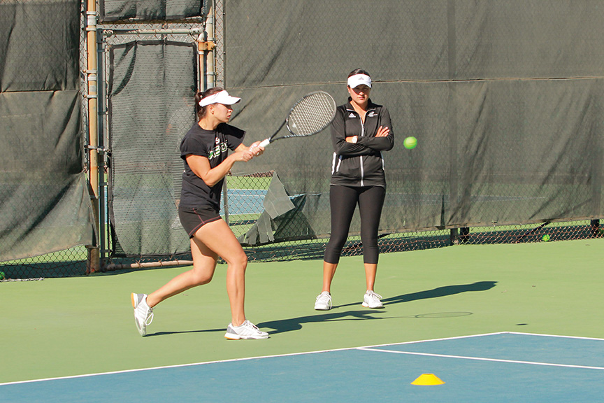 Sacramento+State+women%E2%80%99s+tennis+coach+Clarisse+Baca+watches+senior+Alina+Soltanici+practice+her+backhand+at+the+tennis+courts+on+campus.+Soltanici+has+been+ineligible+to+compete+for+the+last+eight+months+due+to+an+ongoing+investigation.+%28Photo+by+Matthew+Dyer%29