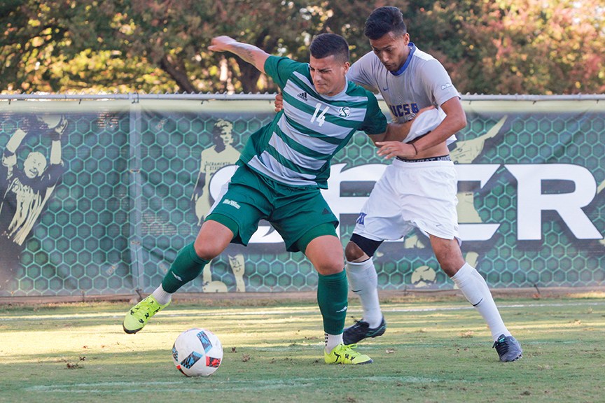 Sacramento State junior forward Cylus Sandoval fights off Josue Espana of UC Santa Barbara for the ball at Hornet Field on Wednesday, Oct. 26. (Photo by Matthew Dyer)